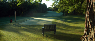 A bench on the golf course